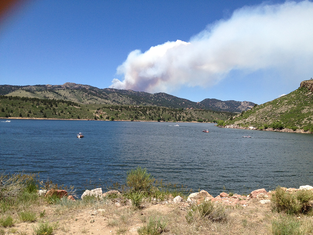 Smoke is visible from Horsetooth Reservoir west of Fort Collins on the afternoon of June 9, 2012
