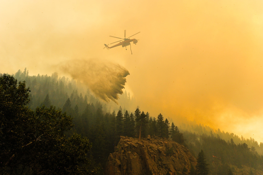 An S-64 Air Crane drops water on the High Park Fire
